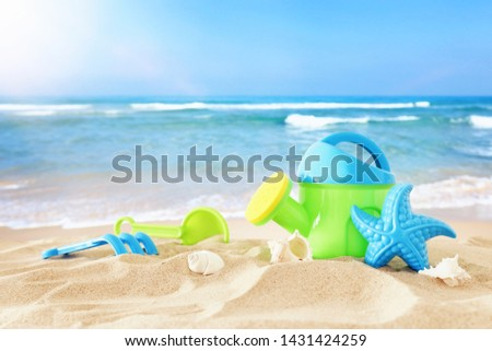 holidays. vacation and summer image with beach colorful toys for kid over the sand #1431424259
