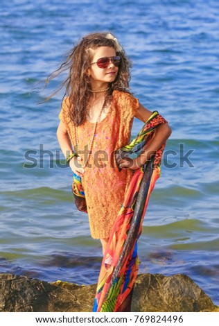 70da1cba6c Holidays, vacation travel and freedom concept. Portrait of girl with long  hair on seaside