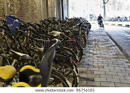 Holland, Amsterdam, bicycles parked in a tunnel near the Central Station
