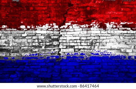 Holland flag painted on old brick wall