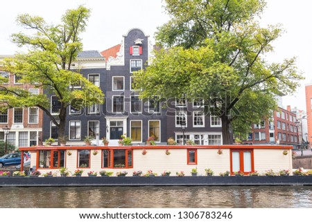 Holland, the typical typical floating house on the river in Amsterdam