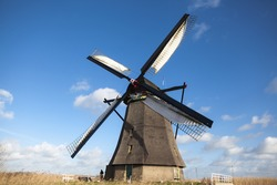 Holland windmill on a canal. Old mill chalk and flour .