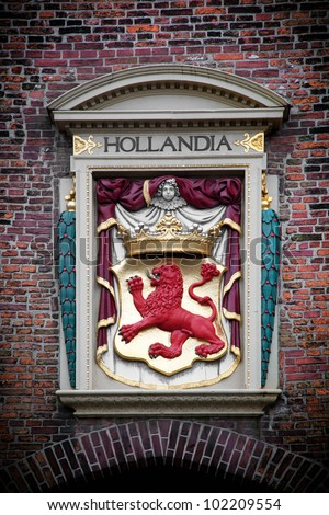 Hollandia sculpture on the building in The Hague (Den Haag), Netherlands