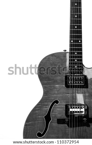 Hollow body electric guitar isolated on white background in black and white - stock photo