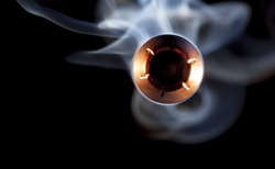Hollow point bullet with smoke that looks like it is coming at the camera
