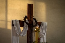 holly cross and candle, whit the Jesuschrist crown of thorns, simbols for celebration of the easter