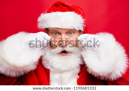 Holly jolly x mas noel coming! December sale discount concept. Mature stylish impressed incredible Santa in costume look at camera with open mouth staring eyes isolated on shine red background #1190681332