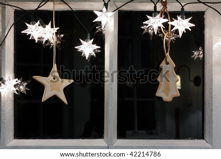 Holly night in double frame of old windows with xmas decoration - stock photo