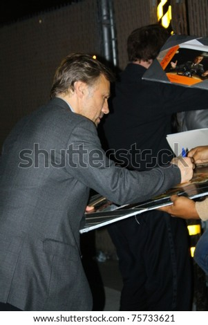 HOLLYWOOD - APRIL 21: Actor Christoph Waltz signs autographs after his appearance on the Jimmy Kimmel show at the Jimmy Kimmel Studios on April 21, 2011 in Hollywood, CA.
