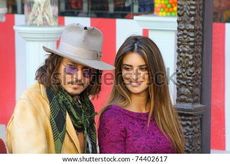 HOLLYWOOD - APRIL 1: Actors Penelope Cruz and Johnny Depp at Cruz's star on the Walk of Fame ceremony on April 1, 2011 Hollywood, CA.