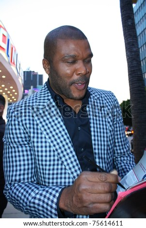 HOLLYWOOD - APRIL 19: Director/actor Tyler Perry signing autographs at the premiere of his new movie Madea's Big Happy Family at the Arclight Cinerama Dome April 19, 2011 Hollywood, CA. - stock photo
