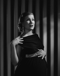 Hollywood black and white, a beautiful pregnant woman - minimal lighting and strong contrast