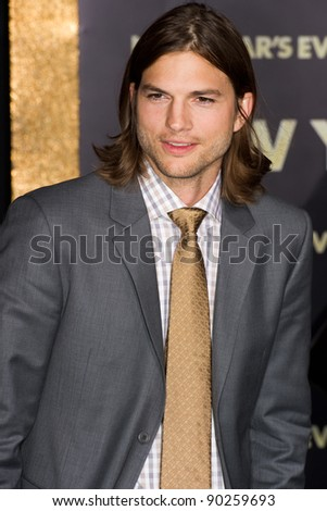 """HOLLYWOOD, CA - DECEMBER 5: Actor Ashton Kutcher arrives at the premiere of """"New Year's Eve"""" at Grauman's Chinese Theater on December 5, 2011 in Hollywood, California"""