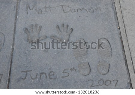 HOLLYWOOD, CA - DECEMBER 7 : Footprints and hand prints of Matt Damon at the Kodak theater pictured on December 7, 2012 in Hollywood, California, USA.