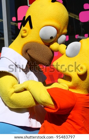 HOLLYWOOD CA - FEBRUARY 14: Homer and Bart Simpson waiting for Matt Groening at his Walk of Fame ceremony where he received his star February 14, 2012 Hollywood, CA.