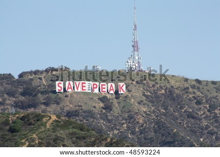 HOLLYWOOD, CA - FEBRUARY 15: The Hollywood word changed for several days to protest plans to build luxury homes on historic sight February 15, 2010 in Hollywood, CA.