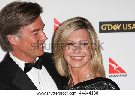 HOLLYWOOD, CA. - JANUARY 16: John Easterling (L) and Olivia Newton-John (R) attend the G'Day USA black tie gala on January 16, 2010 at Hollywood and Highland Grand Ballroom in Hollywood.
