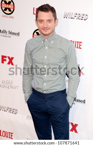 HOLLYWOOD, CA - JUNE 26: Elijah Wood arrives at FX Summer Comedies party at Lure on June 26, 2012 in Hollywood, California.