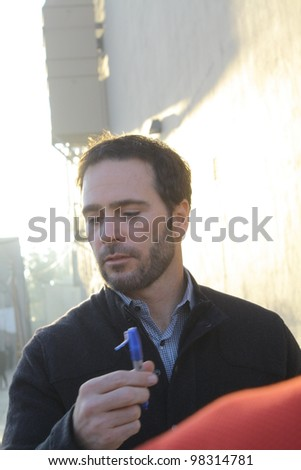 HOLLYWOOD, CA - MARCH 22: Nascar driver Jimmie Johnson signs autographs outside the Jimmy Kimmel studio before his appearance on Jimmy Kimmel Live! on March 22, 2012 in Hollywood, CA.