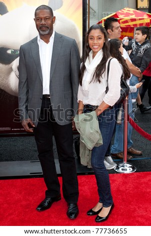 HOLLYWOOD, CA. - MAY 22: Dennis Haysbert (L) and Nicole Haysbert arrive at the Los Angeles premiere of Kung Fu Panda 2 at Grauman's Chinese Theatre on May 22, 2011 in Hollywood, California.