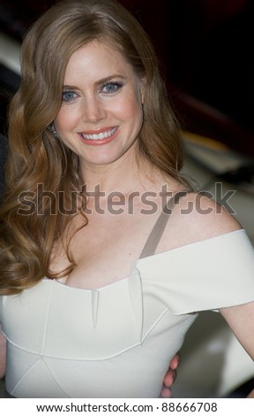 "HOLLYWOOD, CA - NOVEMBER 12: Actor Amy Adams arrives at the Los Angeles premiere of ""The Muppets"" held at the El Capitan Theater on November 12, 2011 in Hollywood, CA"