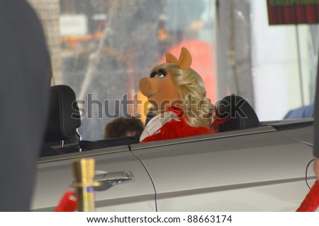 HOLLYWOOD CA - NOVEMBER 12: Diva Miss Piggy arriving in style to the premiere of the latest Muppet Movie at the El Capitan Theatre on November 12, 2011 in Hollywood, CA.