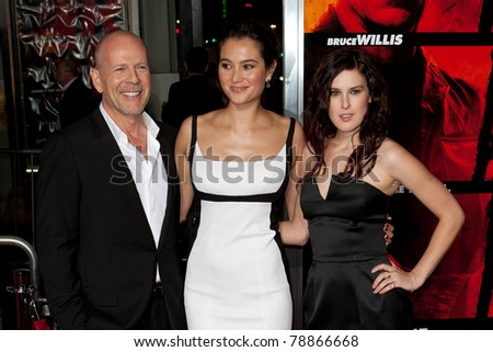 HOLLYWOOD, CA. - OCT 11: (L-R) Emma Heming, Bruce Willis & Rumer Willis arrive at the Los Angeles special screening of Red at Grauman's Chinese Theatre on Oct. 11, 2010 in Hollywood, California. - stock photo