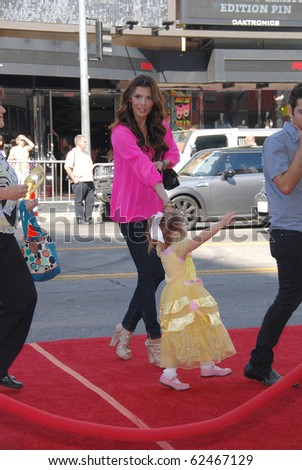 HOLLYWOOD, CA- OCTOBER 2: Actress Ali Landry (C) and Daughter Estela Ines Monteverde arrive at Disney Film  Beauty and The Beast at El Capitan Theatre on October 2, 2010 in Hollywood, California.