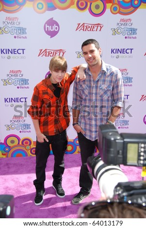 HOLLYWOOD, CA-OCTOBER 24: (L-R)Singer Justin Bieber and his manager Scooter Braunattend the 4th annual Variaty's Power Of Youth even at Paramount Studios on October 24, 2010 in Hollywood, California. - stock photo