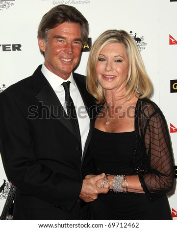 HOLLYWOOD - JAN 22:  Olivia Newton John & husband John arrive at the 2011 G'Day USA Los Angeles Gala on January 22, 2011 in Hollywood, CA - stock photo