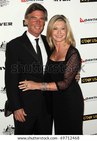 HOLLYWOOD - JAN. 22:   Olivia Newton John & husband arrive at the 2011 G'Day USA Los Angeles Gala  on January 22, 2011 in Hollywood, CA