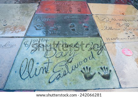 HOLLYWOOD, LOS ANGELES, CA -DEC 12: Movie stars handprints in TCL Chinese Theatre forecourt on Hollywood Boulevard Walk of Fame including Clint Eastwood, Morgan Freeman, and Tom Cruise, Dec 12, 2014.