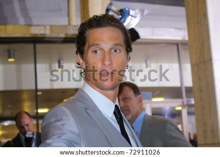 "HOLLYWOOD - MARCH 10: Actor Matthew McConaughey arrives at the premiere of the movie ""The Lincoln Lawyer"" at the Cinerama Dome on March 10, 2011 in Hollywood, CA. - stock photo"