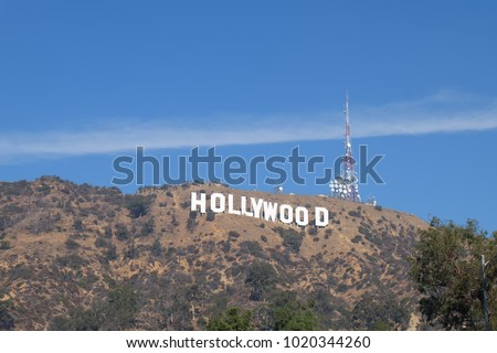 hollywood sign at los angeles with blue sky and sun shine