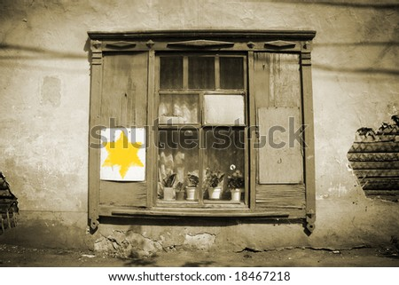 Holocaust sign. Old window and yellow star of David