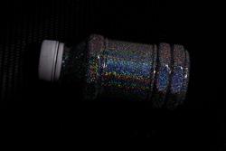 Hologram flakes in a bottle on a Kevlar floor