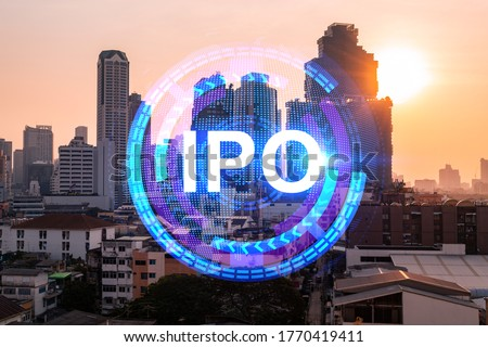 Hologram of IPO glowing icon, sunset panoramic city view of Bangkok. The financial hub for transnational companies in Asia. The concept of boosting the growth by IPO process. Double exposure.