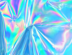 Holograph iridescent texture surface wrinkled foil pastel. Real Hologram Background of wrinkled abstract foil 80s texture with multiple colors. 90s Blue pastel holographic gradient  template surface.