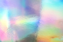 Holographic foil paper close-up. Modern trendy colorful background