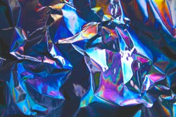 Holographic iridescent foil texture background. It can be used for posters, cards, flyers, brochures, magazines and any kind of cover