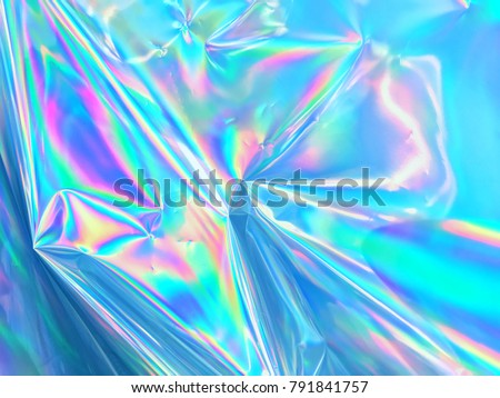 Holographic iridescent surface wrinkled foil pastel. Real Hologram Background of wrinkled abstract foil 80s texture with multiple colors. 90s Blue pastel holographic gradient mesh template surface.