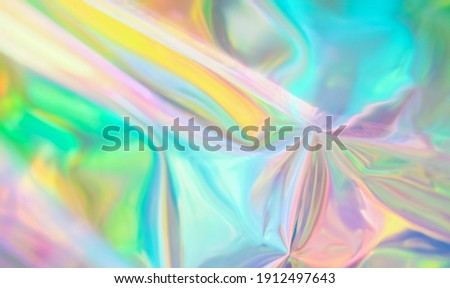 Holographic iridescent surface wrinkled vaporwave wavy abstract  blurred background. Texture with multiple colors of webpunk in 80's style. Retro creative concept.