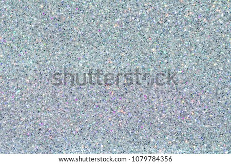 Holographic multicolor chrome texture. Sequins powder. Colored glitter. Shining background
