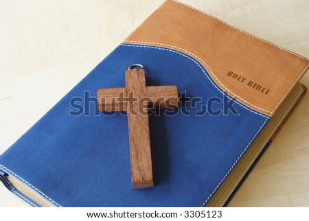 Holy Bible and cross on top