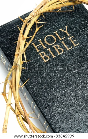 holy bible  and crown of thorns isolated on white background
