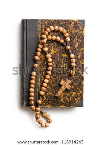 holy bible and rosary beads on white background
