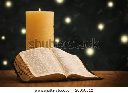 Holy Bible in front of Christmas tree