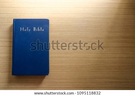 Holy Bible on a wooden background. Christianity concept. Holy Bible background. Holy Bible wallpaper. Faith hope love concept. #1095118832