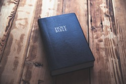 Holy Bible on the wooden table background