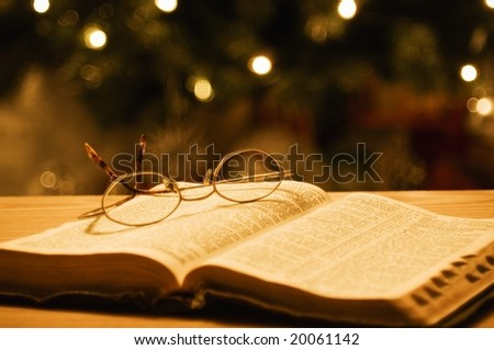 holy bible with eyeglasses